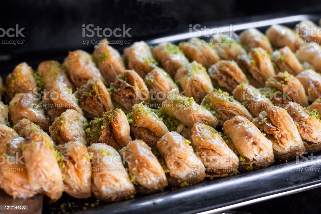 Traditional Turkish dessert - baklava with pistachios on the tray stock photo
