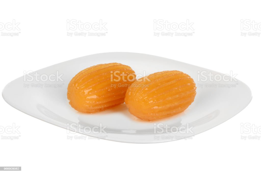 Traditional Turkish dessert tulumba on plate stock photo