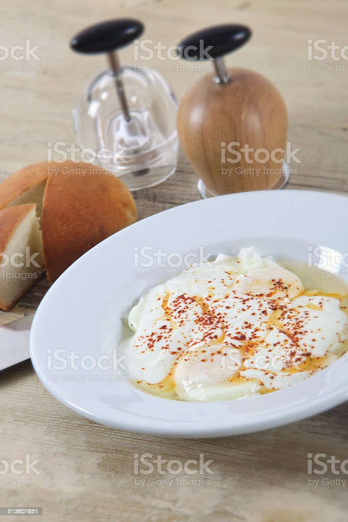 Traditional Turkish style poached egg stock photo