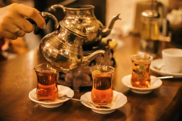 Traditional turkish tea ceremony in cafe stock photo