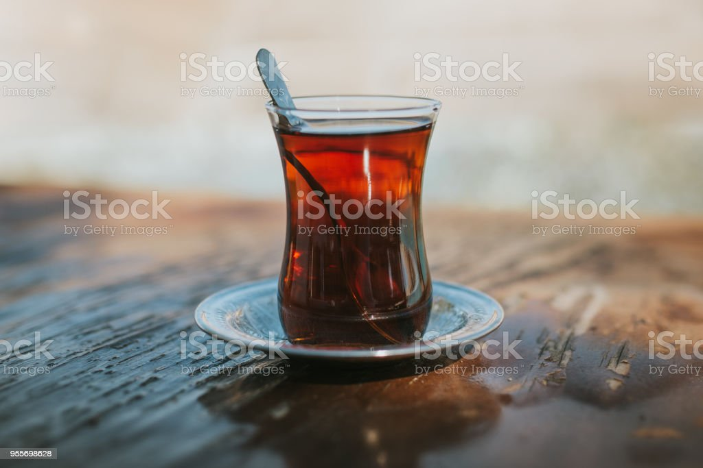 traditional Turkish tea on the wooden background .