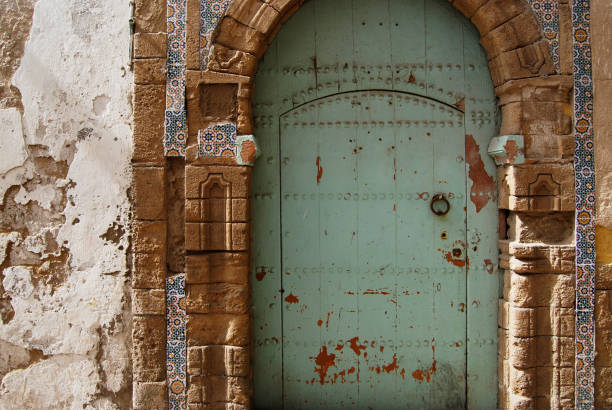 traditional turquoise riad door - north africa stock photos and pictures