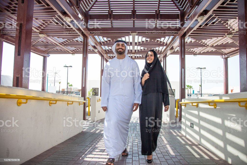 Traditional UAE young couple enjoying life outdoor stock photo