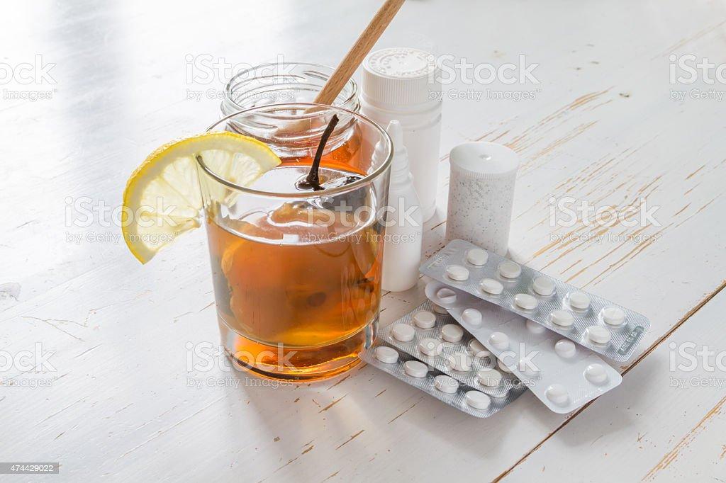 Traditional ukrainian drink in glass with honey, lemon, drugs, vitamins stock photo