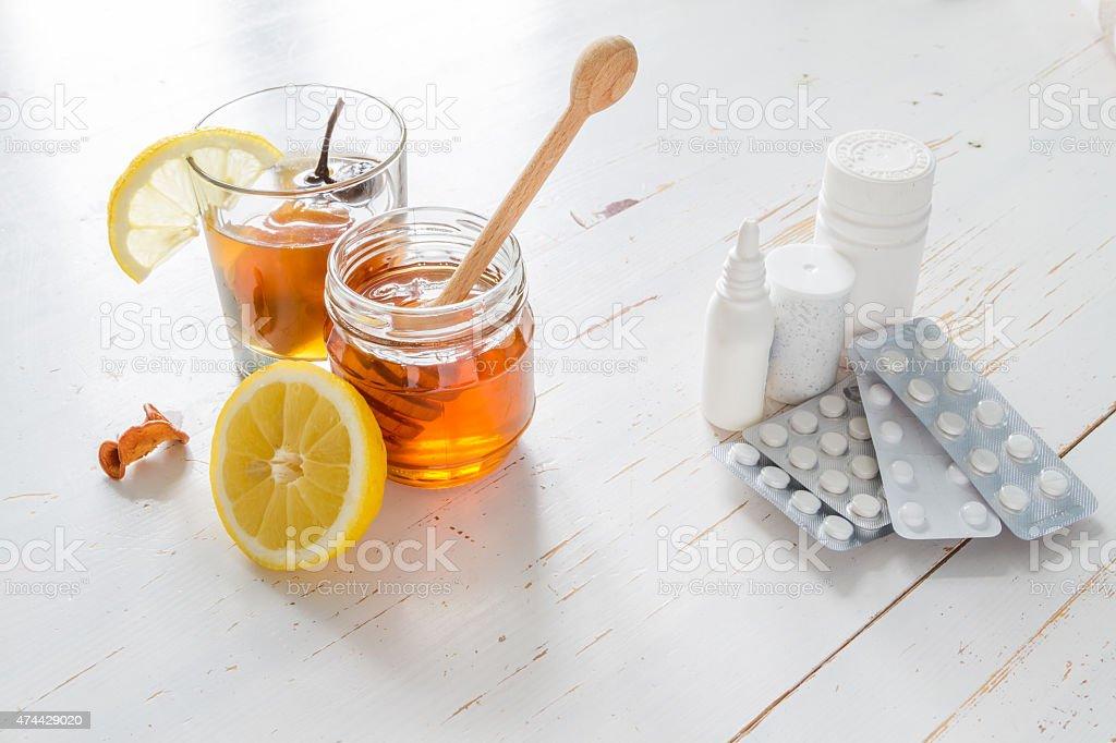 Traditional ukrainian drink in glass with honey, lemon Vs drugs stock photo