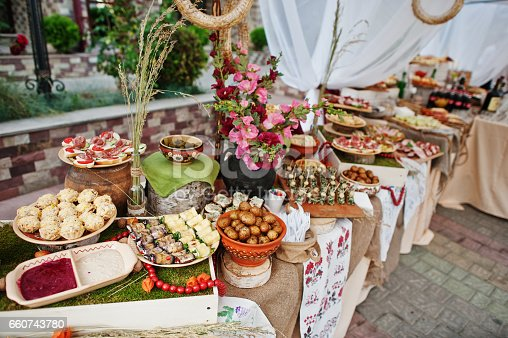 istock Traditional ukrainian food at wedding reception outdoor. 660743780