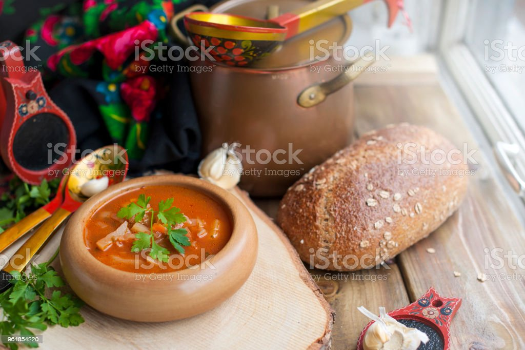 Traditional Ukrainian Russian borscht with white beans on the bowl royalty-free stock photo
