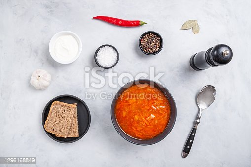 istock Traditional ukrainian russian soup (borscht) with bread and sour cream 1296168849
