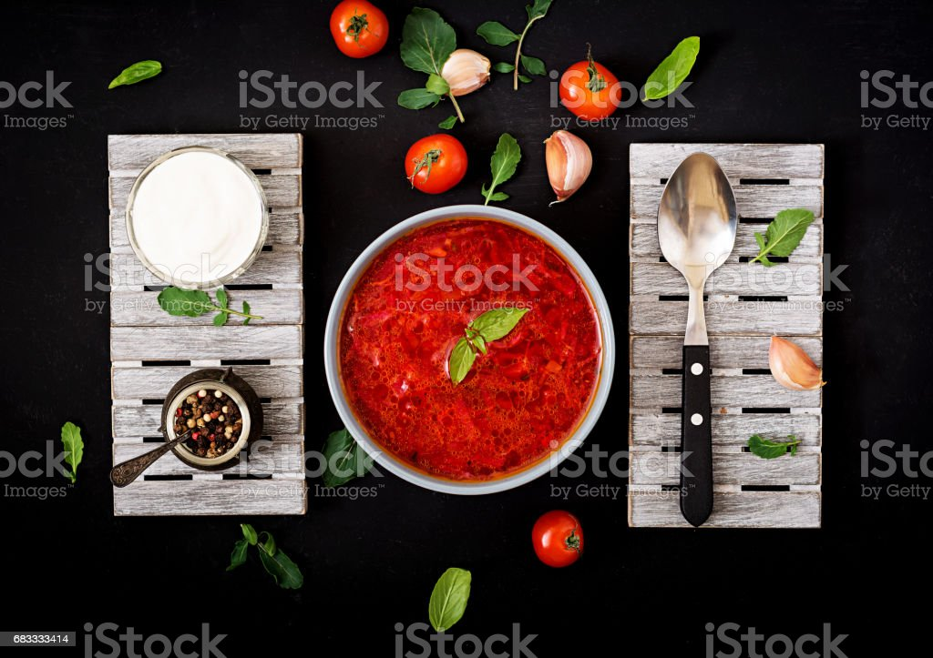 Traditional Ukrainian Russian vegetable borscht soup  on blue bowl. Flat lay. Top view royalty-free stock photo