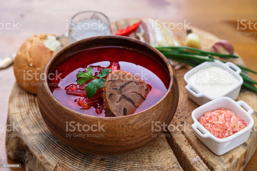 Traditional Ukrainian Russian vegetable soup, borsch with garlic donuts, pampushki stock photo