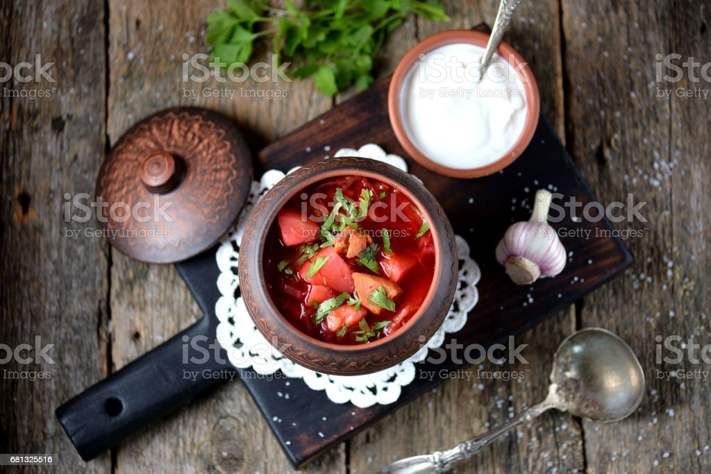 Traditional Ukrainian soup borscht on an old wooden background. Rustic style. royalty-free stock photo