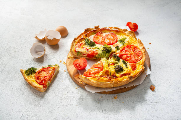 Traditional vegetable quiche with broccoli sliced stock photo