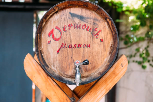 traditional vermouth wooden barrel in outdoors spanish house during sunny summer day stock photo