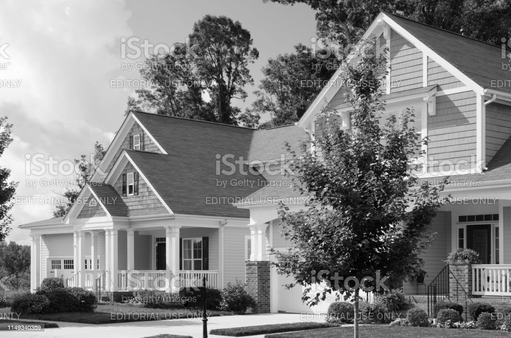 Traditional Victorian Cottage Style Homes In A Residential Neighborhood Captured In Black And White Stock Photo Download Image Now Istock