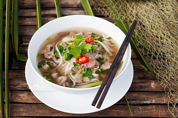 traditional vietnamese beef soup pho - pho soup stock photos and pictures