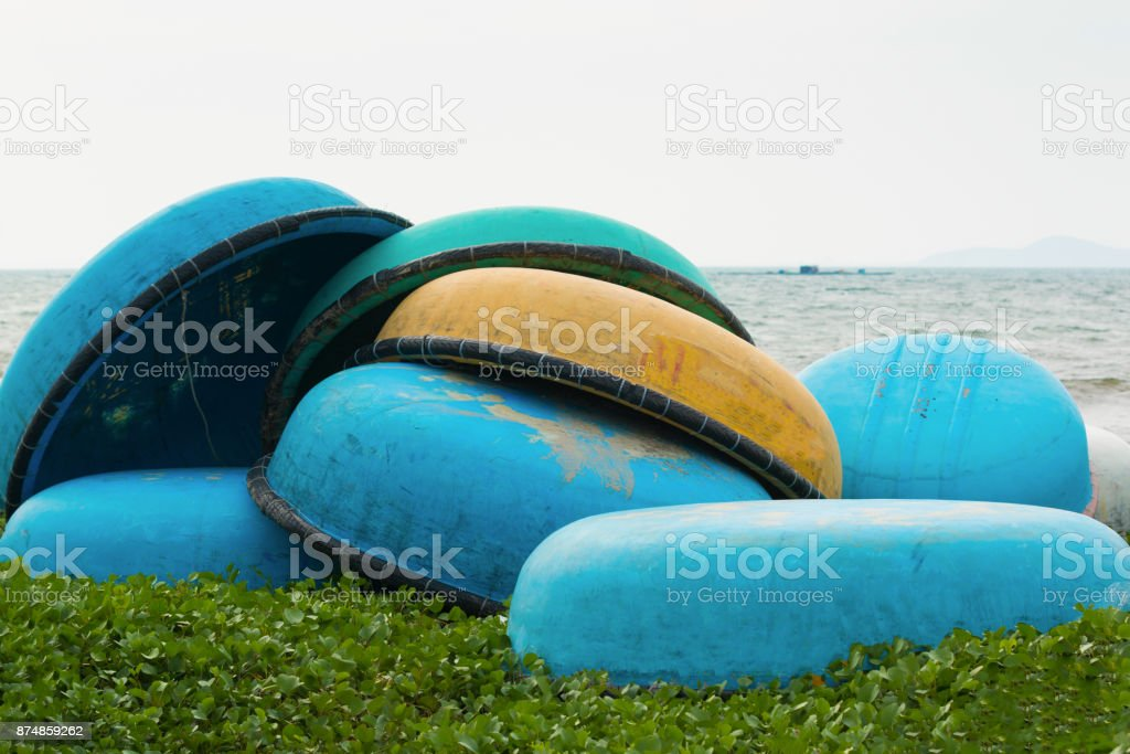 Traditional Vietnamese fishing coracles on beach, boats in fishing village stock photo