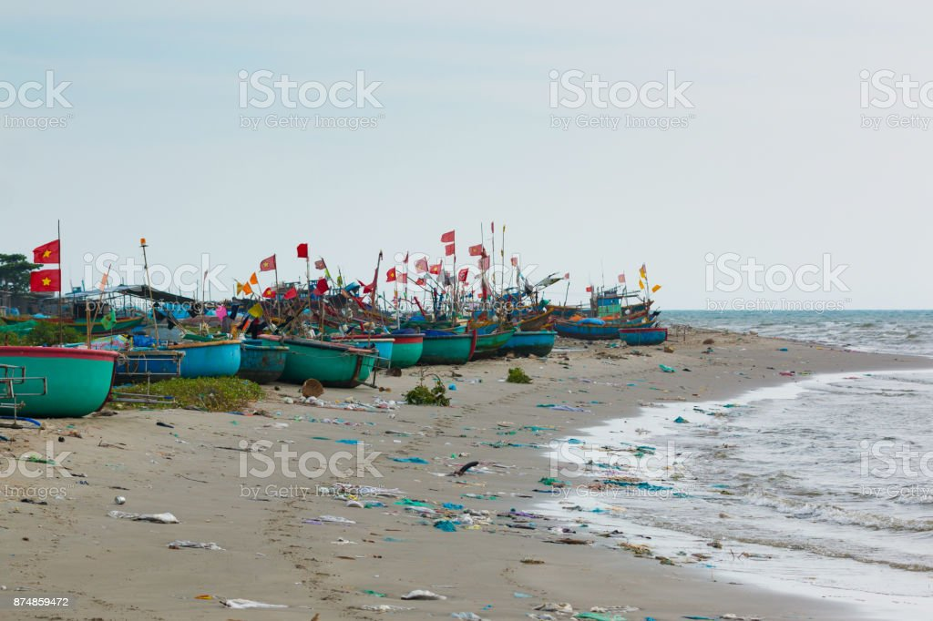 Traditional Vietnamese fishing coracles on Polluted beach in a fishing village in Vietnam stock photo