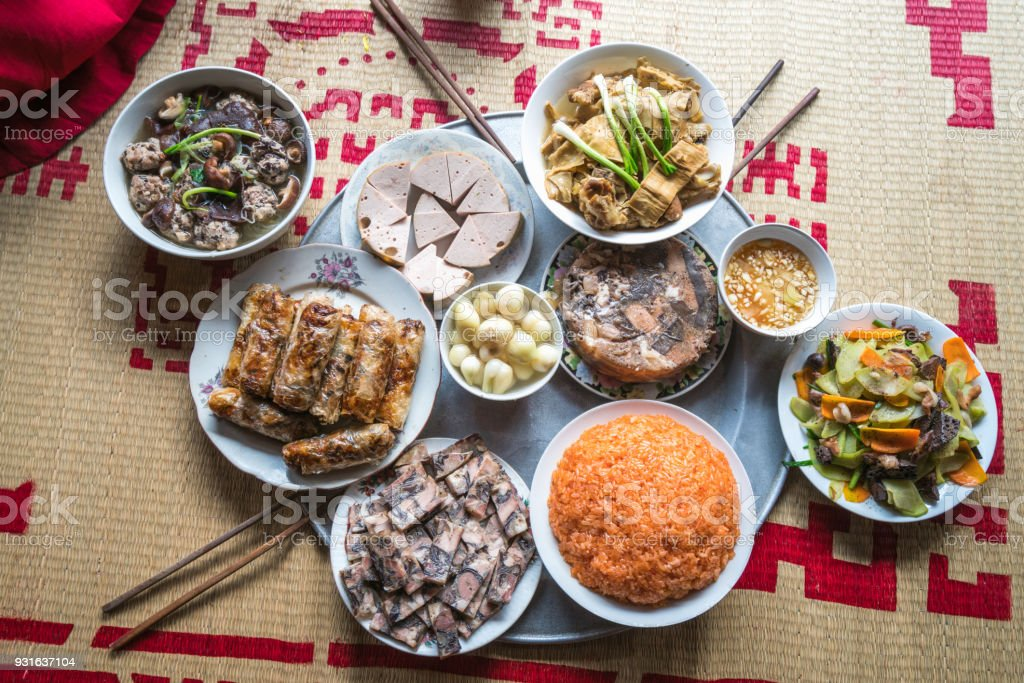 A traditional Vietnamese meal for lunar new year Tet holiday in spring, placed on new flowered sedge mat, on the last day of the last year stock photo