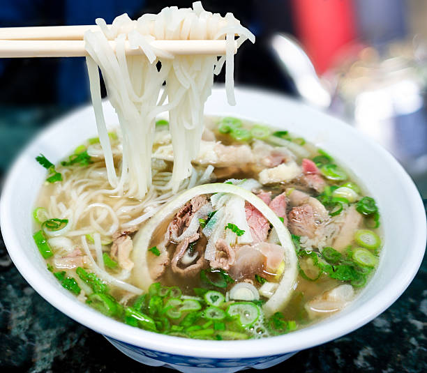 traditional vietnamese pho beef noodle soup - pho soup stock photos and pictures