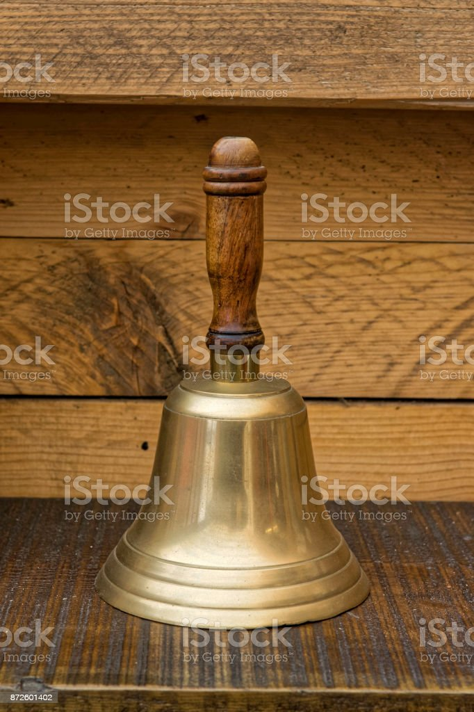 Traditional vintage hand bell often used for start, end,break and lunch times by the school janitor. stock photo