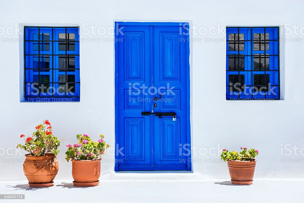 Traditional White Church with Blue Doors in Santorini, Greece stock photo