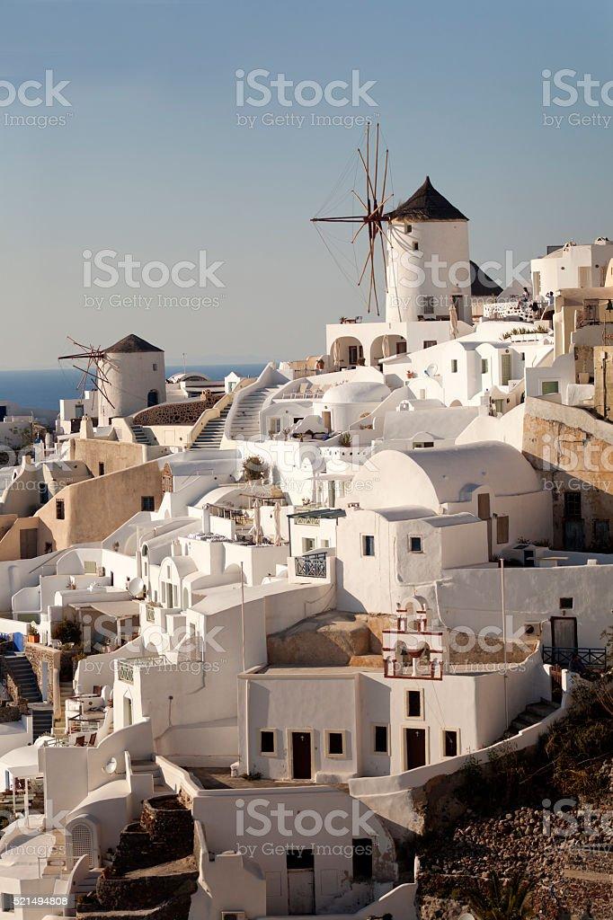Traditional white Greek houses in Oia on Santorini island stock photo