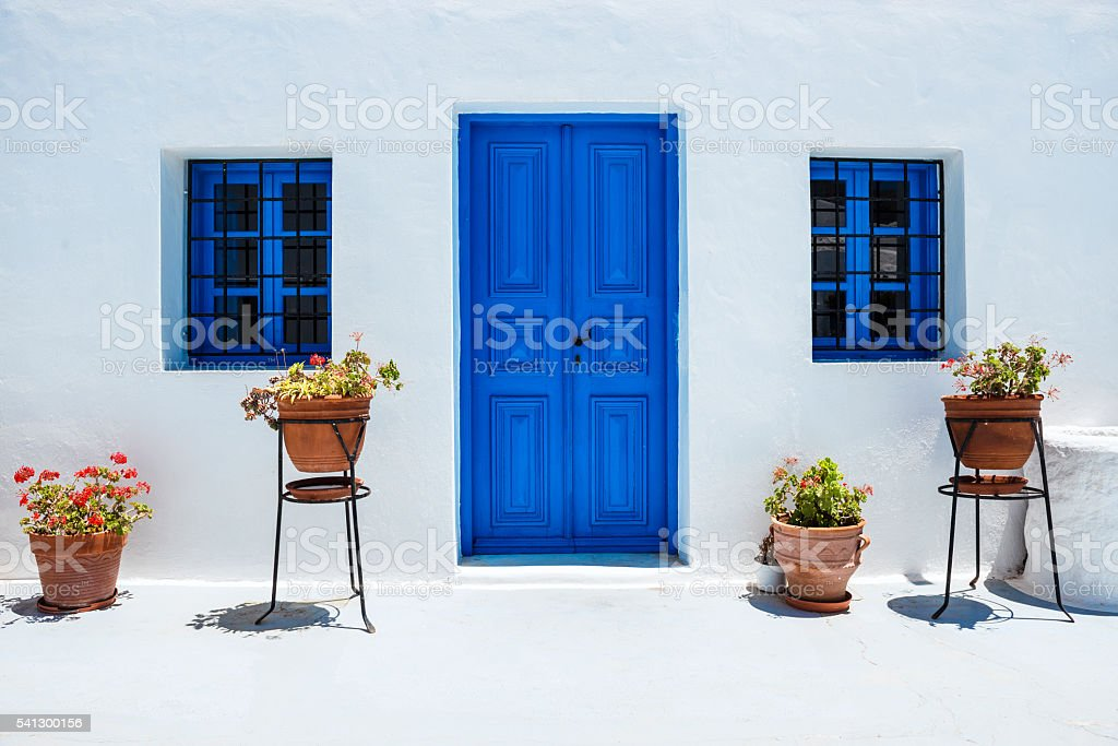 Traditional White Houses with Blue Doors in Santorini, Greece stock photo