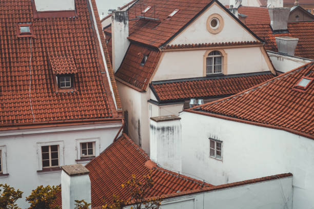 Traditional white houses with red roof in Prague historical center stock photo