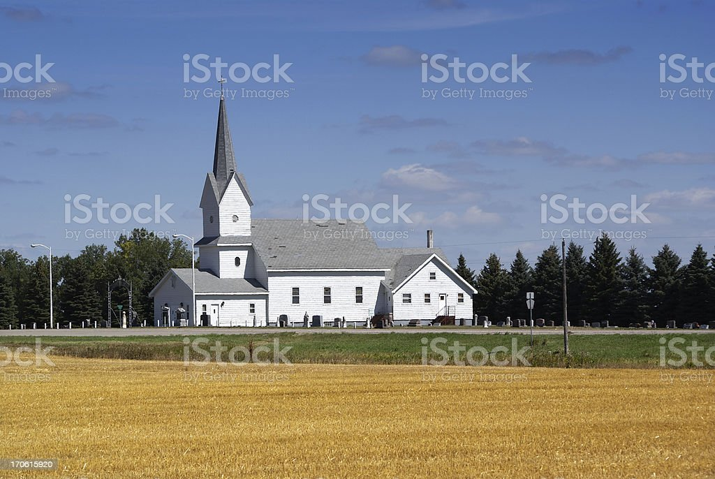 Traditional White Rural Church with Wheat Field in Foreground royalty-free stock photo