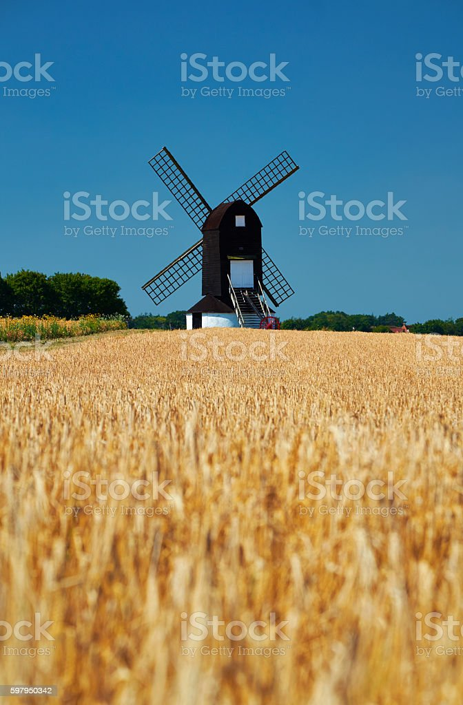 Traditional Windmill And Cereal Crop stock photo