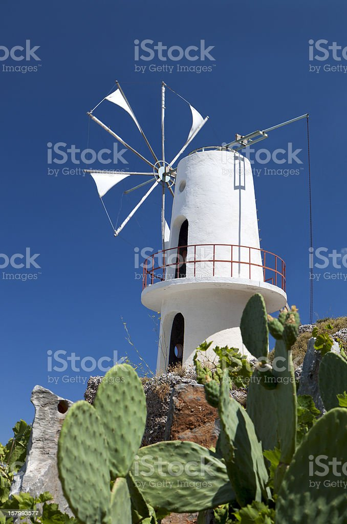 Traditional windmill at Crete island in Greece stock photo