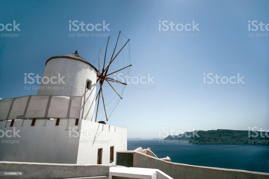 Traditional Windmill In Greek Island Of Santorini On Sunrise Stock