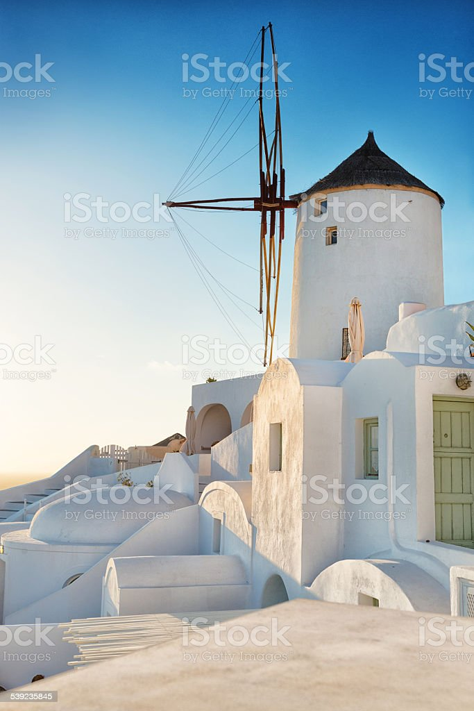 Traditional Windmill in Greek island of Santorini on Sunset royalty-free stock photo