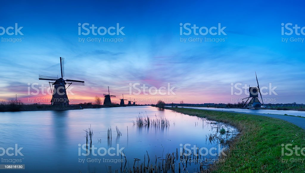 Traditional windmills at sunrise, Kinderdijk, The Netherlands royalty-free stock photo