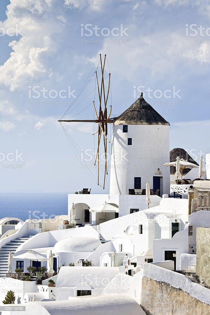 Traditional windmills in village Oia Cyclades island Santorini stock photo