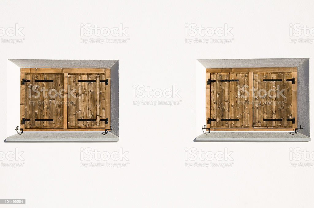Traditional windows with wooden shutters stock photo
