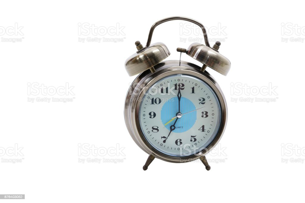 Traditional wind-up (keywound), mechanical, spring-driven alarm clock isolated on white background stock photo