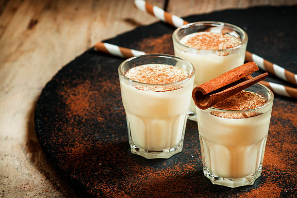 Traditional winter eggnog  with milk, rum and cinnamon stock photo