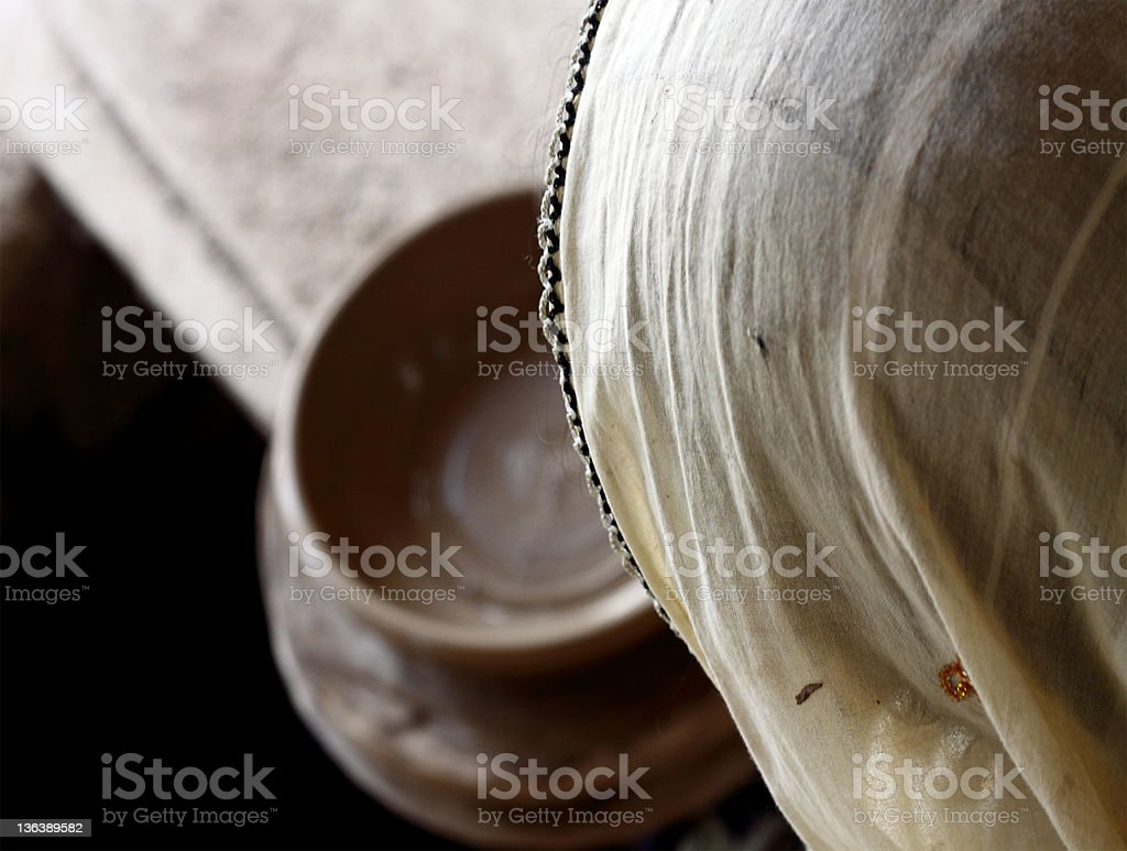 Traditional Woman Making Pottery stock photo