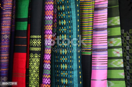 Traditional womans clothing made of colourful silk fabric with different fabrics, Yangon, Myanmar.