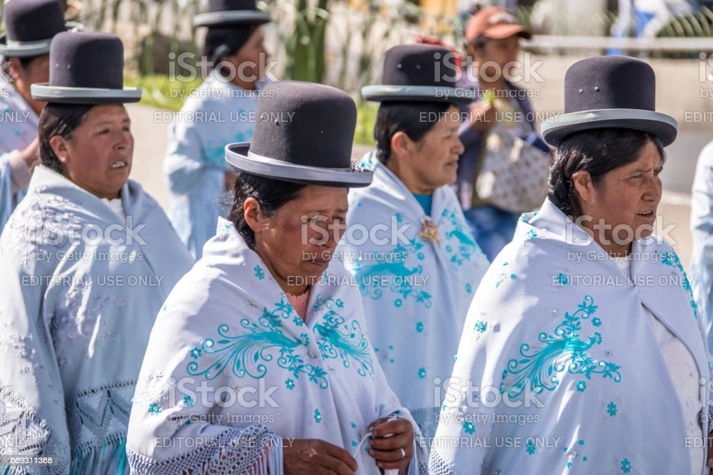 Traditional Women (Cholitas) in Typical Clothes during 1st of May Labor Day Parade - La Paz, Bolivia stock photo