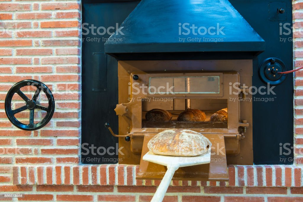 Traditional wood oven in a bakery stock photo