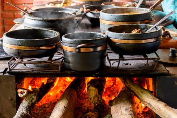 Traditional wood stove preparing typical and traditional food stock photo