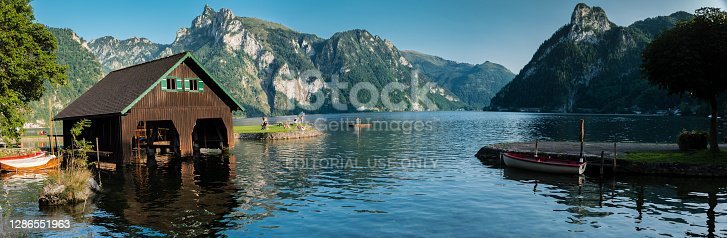 istock A traditional wooden boat house at the lakeshore of the Traunsee with the Erlakogel mountain in the background - Traunkirchen, Salzkammergut, Austria 1286551963