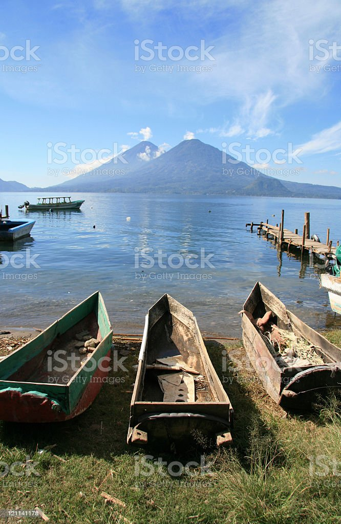 Traditional wooden boats by lake Atitlan in town Panajachel, Guatemala stock photo