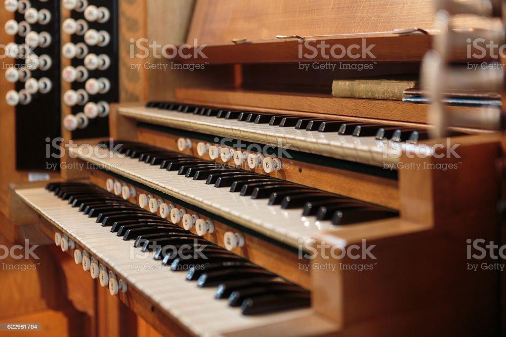 Traditional wooden church organ stock photo