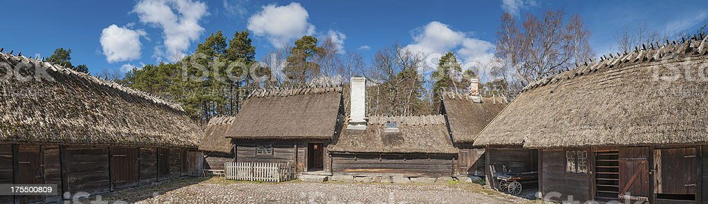 Traditional wooden farmhouse barns thatched roof royalty-free stock photo