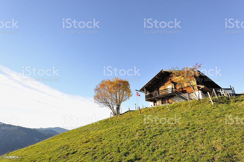 Traditional Wooden House in the Swiss Alps royalty-free stock photo