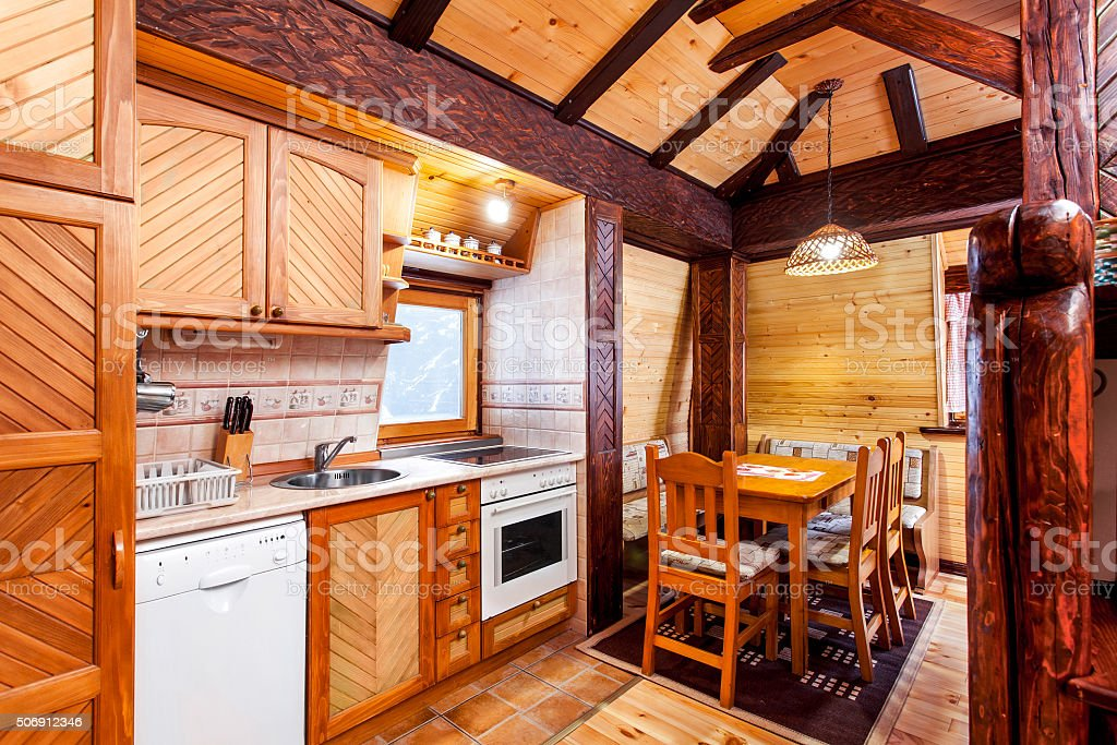 Traditional wooden interior with table and fixtures - mountain resort stock photo