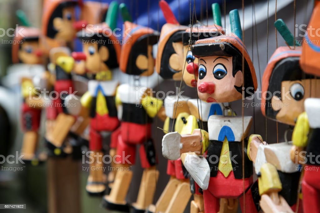 Traditional wooden Pinocchio toy on the market stock photo